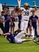 Sep 28, 2013; Dallas, TX, USA; Army Black Knights fullback Tirone Young (38) jumps over Louisiana Tech Bulldogs kicker Kyle Fischer (15) during second quarter at the Cotton Bowl Stadium. Mandatory Credit: Jerome Miron-USA TODAY Sports