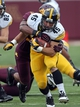 Sep 28, 2013; Minneapolis, MN, USA; Iowa Hawkeyes fullback Mark Weisman (45) runs with the ball in the second half against the Minnesota Golden Gophers at TCF Bank Stadium. The Hawkeyes won 23-7. Mandatory Credit: Jesse Johnson-USA TODAY Sports