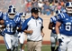 Sep 28, 2013; Durham, NC, USA;  Duke Blue Devils head coach David Cutcliffe runs out on the field before the start of their game against the Troy Trojans at Wallace Wade Stadium. Mandatory Credit: Mark Dolejs-USA TODAY Sports