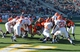 Sep 28, 2013; Fort Collins, CO, USA; Colorado State Rams quarterback Garrett Grayson (18) (center) scores on rushing touchdown against the UTEP Miners in the fourth quarter at Hughes Stadium. The Rams defeated the Miners 59-42. Mandatory Credit: Ron Chenoy-USA TODAY Sports