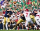 Sep 28, 2013; South Bend, IN, USA; Notre Dame Fighting Irish quarterback Tommy Rees (11) throws in the first quarter against the Oklahoma Sooners at Notre Dame Stadium. Oklahoma won 35-21. Mandatory Credit: Matt Cashore-USA TODAY Sports