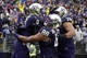 Sep 28, 2013; Seattle, WA, USA; Washington Huskies wide receiver Kevin Smith (8) celebrates a touchdown reception against the Arizona Wildcats with tight end Austin Seferian-Jenkins (88) and offensive linesman Mike Criste (78) during the first quarter at Husky Stadium. Mandatory Credit: Joe Nicholson-USA TODAY Sports