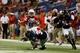 Sep 28, 2013; San Antonio, TX, USA; Houston Cougars defensive back Zachary McMillian (10) recovers a fumble from Texas-San Antonio Roadrunners running back Evans Okotcha (36) during the second  half at Alamodome. Houston won 59 - 28. Mandatory Credit: Soobum Im-USA TODAY Sports