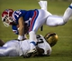 Sep 28, 2013; Dallas, TX, USA; Army Black Knights linebacker Tyler McLees (33) tackles Louisiana Tech Bulldogs wide receiver Andrew Guillot (19) during second half at the Cotton Bowl Stadium. The Black Knights defeated the Bulldogs 35-16. Mandatory Credit: Jerome Miron-USA TODAY Sports