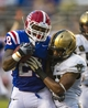 Sep 28, 2013; Dallas, TX, USA; Louisiana Tech Bulldogs running back Kenneth Dixon (28) scores a touchdown in front of Army Black Knights linebacker Reggie Nesbit (25) during second half at the Cotton Bowl Stadium. The Black Knights defeated the Bulldogs 35-16. Mandatory Credit: Jerome Miron-USA TODAY Sports