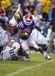 Sep 28, 2013; Dallas, TX, USA; Louisiana Tech Bulldogs running back Kenneth Dixon (28) is tackled by Army Black Knights defensive lineman Mike Ugenyi (92) and defensive end Robert Kough (99) during second half at the Cotton Bowl Stadium. The Black Knights defeated the Bulldogs 35-16. Mandatory Credit: Jerome Miron-USA TODAY Sports