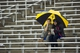 Sep 28, 2013; Dallas, TX, USA; Two fans of the Army Black Knights wait out the rain delay during the first half of the game between the Black Knights and the Louisiana Tech Bulldogs at the Cotton Bowl Stadium. The Black Knights defeated the Bulldogs 35-16. Mandatory Credit: Jerome Miron-USA TODAY Sports