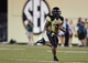 Sep 28, 2013; Nashville, TN, USA; Vanderbilt Commodores running back Jerron Seymour (3) runs for a touchdown against the Alabama-Birmingham Blazers during the first half at Vanderbilt Stadium. Mandatory Credit: Don McPeak-USA TODAY Sports