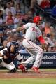 Sep 28, 2013; Atlanta, GA, USA; Philadelphia Phillies left fielder Domonic Brown (9) hits a RBI single against the Atlanta Braves in the seventh inning at Turner Field. Mandatory Credit: Brett Davis-USA TODAY Sports