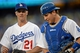 Sep 28, 2013; Los Angeles, CA, USA;   Los Angeles Dodgers starting pitcher Zack Greinke (21) and catcher A.J. Ellis (17) walk off the field after the first inning of the game against the Colorado Rockies at Dodger Stadium. Mandatory Credit: Jayne Kamin-Oncea-USA TODAY Sports
