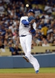 Sep 28, 2013; Los Angeles, CA, USA;   Los Angeles Dodgers shortstop Hanley Ramirez (13) makes a play during the game against the Colorado Rockies at Dodger Stadium. Mandatory Credit: Jayne Kamin-Oncea-USA TODAY Sports