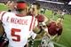 Sep 28, 2013; Tuscaloosa, AL, USA; Alabama Crimson Tide quarterback A.J. McCarron (10) greets Mississippi Rebels defensive end Robert Nkemdiche (5) following Alabama 25-0 victory over the Mississippi Rebels at Bryant-Denny Stadium. Mandatory Credit: John David Mercer-USA TODAY Sports