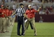 Sep 28, 2013; Tuscaloosa, AL, USA; Mississippi Rebels head coach Hugh Freeze talks head linesman Chad Green after questioning a call on the field against the Alabama Crimson Tide during the third quarter at Bryant-Denny Stadium. The Alabama Crimson Tide defeated the Mississippi Rebels 25-0. Mandatory Credit: John David Mercer-USA TODAY Sports