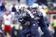 Sep 28, 2013; Seattle, WA, USA; Washington Huskies quarterback Keith Price (17) hands off to Washington Huskies running back Bishop Sankey (25) during the second quarter against the Arizona Wildcats at Husky Stadium. Mandatory Credit: Joe Nicholson-USA TODAY Sports