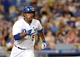 Sep 28, 2013; Los Angeles, CA, USA;  Los Angeles Dodgers third baseman Juan Uribe (5) doubles in the sixth inning of the game against the Colorado Rockies at Dodger Stadium. Mandatory Credit: Jayne Kamin-Oncea-USA TODAY Sports