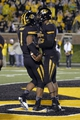 Sep 28, 2013; Columbia, MO, USA; Missouri Tigers quarterback James Franklin (1) is congratulated by wide receiver Marcus Lucas (85) after scoring a touchdown against the Arkansas State Red Wolves during the second half at Faurot Field. Mandatory Credit: Jasen Vinlove-USA TODAY Sports