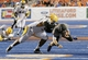 Sep 28, 2013; Boise, ID, USA; Boise State Broncos quarterback Grant Hedrick (9) is brought down by Southern Miss Golden Eagles defensive lineman Khyri Thornton (98) as Hedrick runs for a first down during the second half against the Southern Miss Golden Eagles at Bronco Stadium. Boise State defeated Southern Miss 60-7. Mandatory Credit: Brian Losness-USA TODAY Sports