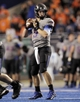 Sep 28, 2013; Boise, ID, USA; Boise State Broncos quarterback Grant Hedrick (9) looks for an open receiver during the second half against the Southern Miss Golden Eagles at Bronco Stadium. Boise State defeated Southern Miss 60-7. Mandatory Credit: Brian Losness-USA TODAY Sports