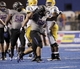 Sep 28, 2013; Boise, ID, USA; Boise State Broncos defensive tackle Justin Taimatuia (90) celebrates a sack during the second half against the Southern Miss Golden Eagles at Bronco Stadium. Boise State defeated Southern Miss 60-7. Mandatory Credit: Brian Losness-USA TODAY Sports
