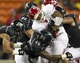 Sep 28, 2013; Honolulu, HI, USA; Fresno State running back Marteze Waller (33) gets stopped by the Hawaii defense during the third quarter of the NCAA college football game at Aloha Stadium. Mandatory Credit: Marco Garcia-USA TODAY Sports