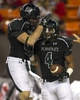 Sep 28, 2013; Honolulu, HI, USA; Hawaii running back Steven Lakalaka (4) celebrates with teammate Hawaii tight end Clark Evans (84) after making a touchdown against Fresno State during the third quarter of the NCAA college football game at Aloha Stadium. Mandatory Credit: Marco Garcia-USA TODAY Sports