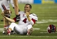 Sep 28, 2013; Honolulu, HI, USA; Fresno State quarterback Derek Carr (4) reacts after losing his helmet in a tackle against Hawaii in the fourth quarter of the NCAA college football game at Aloha Stadium. Mandatory Credit: Marco Garcia-USA TODAY Sports