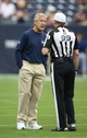 Sep 29, 2013; Houston, TX, USA; Seattle Seahawks head coach Pete Carroll talks to referee Tony Corrente (99)  prior to the game against the Houston Texans at Reliant Stadium. Mandatory Credit: Matthew Emmons-USA TODAY Sports
