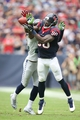 Sep 29, 2013; Houston, TX, USA; Houston Texans receiver Andre Johnson (80) catches a pass in the second quarter against Seattle Seahawks cornerback Richard Sherman (25) at Reliant Stadium. Mandatory Credit: Matthew Emmons-USA TODAY Sports
