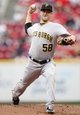 Sep 29, 2013; Cincinnati, OH, USA; Pittsburgh Pirates starting pitcher Brandon Cumpton (58) pitches during the first inning against the Cincinnati Reds at Great American Ball Park. Mandatory Credit: Frank Victores-USA TODAY Sports