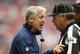 Sep 29, 2013; Houston, TX, USA; Seattle Seahawks head coach Pete Carroll yells at head linesman George Hayward (54) in the second quarter against the Houston Texans at Reliant Stadium. Mandatory Credit: Matthew Emmons-USA TODAY Sports