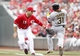 Sep 29, 2013; Cincinnati, OH, USA; Cincinnati Reds first baseman Joey Votto (19) attempts a tag on the Pittsburgh Pirates right fielder Jose Tabata (31) during the first inning at Great American Ball Park. Mandatory Credit: Frank Victores-USA TODAY Sports