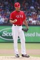 Sep 29, 2013; Arlington, TX, USA; Texas Rangers starting pitcher Yu Darvish (11) looks at the ball after giving up a home run in the first inning of the game against the Los Angeles Angels at Rangers Ballpark in Arlington. Mandatory Credit: Tim Heitman-USA TODAY Sports