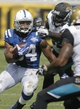 Sep 29, 2013; Jacksonville, FL, USA; Indianapolis Colts running back Trent Richardson (34) is chased by Jacksonville Jaguars defensive tackle Sen'Derrick Marks (99) and cornerback Will Blackmon (24) in the second quarter of their game at EverBank Field. Mandatory Credit: Phil Sears-USA TODAY Sports