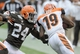 Sep 29, 2013; Cleveland, OH, USA; Cleveland Browns cornerback Johnson Bademosi (24) tackles Cincinnati Bengals wide receiver Brandon Tate (19) during the fourth quarter at FirstEnergy Stadium. The Browns beat the Bengals 17-6.  Mandatory Credit: Ken Blaze-USA TODAY Sports