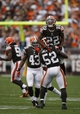 Sep 29, 2013; Cleveland, OH, USA; Cleveland Browns inside linebacker D'Qwell Jackson (52) picks up cornerback Buster Skrine (22) during the fourth quarter against the Cincinnati Bengals at FirstEnergy Stadium. Browns beat the Bengals 17-6. Mandatory Credit: Raj Mehta-USA TODAY Sports