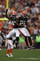 Sep 29, 2013; Cleveland, OH, USA; Cleveland Browns cornerback Buster Skrine (22) celebrates with strong safety T.J. Ward (43) during the fourth quarter against the Cincinnati Bengals at FirstEnergy Stadium. Browns beat the Bengals 17-6. Mandatory Credit: Raj Mehta-USA TODAY Sports