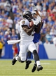 Sep 29, 2013; Orchard Park, NY, USA; Buffalo Bills defensive back Brandon Burton (29) tries to break up a pass to Baltimore Ravens free safety Michael Huff (29) during the second half at Ralph Wilson Stadium. Bills beat Ravens 23 to 20.  Mandatory Credit: Timothy T. Ludwig-USA TODAY Sports