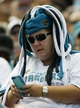 Sep 29, 2013; Jacksonville, FL, USA; A Jacksonville Jaguars fan checks her phone during the first half of their game against the Indianapolis Colts at EverBank Field. The Indianapolis Colts beat the Jacksonville Jaguars 37-3. Mandatory Credit: Phil Sears-USA TODAY Sports