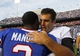 Sep 29, 2013; Orchard Park, NY, USA; Buffalo Bills quarterback EJ Manuel (3) and Baltimore Ravens quarterback Joe Flacco (5) after a game at Ralph Wilson Stadium. Bills beat Ravens 23 to 20.  Mandatory Credit: Timothy T. Ludwig-USA TODAY Sports