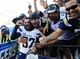Sep 29, 2013; San Diego, CA, USA; San Diego Chargers safety Eric Weddle (32) celebrates with fans following a win against the Dallas Cowboys at Qualcomm Stadium. The Chargers won 30-21. Mandatory Credit: Christopher Hanewinckel-USA TODAY Sports