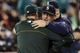 Sep 29, 2013; Seattle, WA, USA; Oakland Athletics manager Bob Melvin (6) and Seattle Mariners manager Eric Wedge (22) hug after the game between the Seattle Mariners and the Oakland Athletics at Safeco Field. Oakland defeated Seattle 9-0. Mandatory Credit: Steven Bisig-USA TODAY Sports