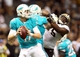 Sep 30, 2013; New Orleans, LA, USA; Miami Dolphins quarterback Ryan Tannehill (17) looks to pass the ball against the New Orleans Saints in the fourth quarter at Mercedes-Benz Superdome. New Orleans defeated Miami 38-17. Mandatory Credit: Crystal LoGiudice-USA TODAY Sports