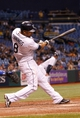 Sep 18, 2013; St. Petersburg, FL, USA; Tampa Bay Rays center fielder Desmond Jennings (8) hits the game winning RBI single during the twelfth inning against the Texas Rangers at Tropicana Field. Tampa Bay Rays defeated the Texas Rangers 4-3 in twelve inning. Mandatory Credit: Kim Klement-USA TODAY Sports