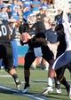 Sep 28, 2013; Buffalo, NY, USA; Buffalo Bulls quarterback Joe Licata (16) drops to pass against the Connecticut Huskies at University of Buffalo Stadium. Buffalo beat Connecticut 41-12. Mandatory Credit: Kevin Hoffman-USA TODAY Sports