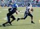 Sep 28, 2013; Buffalo, NY, USA; Buffalo Bulls defensive back Najja Johnson (22) pursues Connecticut Huskies running back Lyle McCombs (43) during the game at University of Buffalo Stadium. Buffalo beat Connecticut 41-12. Mandatory Credit: Kevin Hoffman-USA TODAY Sports