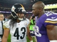 Sep 29, 2013; London, UNITED KINGDOM; Pittsburgh Steelers safety Troy Polamalu (43) and Minnesota Vikings running back Adrian Peterson (28) after the NFL International Series game at Wembley Stadium. The Vikings defeated the Steelers 34-27. Mandatory Credit: Kirby Lee-USA TODAY Sports