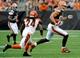 Sep 29, 2013; Cleveland, OH, USA; Cleveland Browns tight end Jordan Cameron (84) runs against Cincinnati Bengals cornerback Adam Jones (24) at FirstEnergy Stadium. Mandatory Credit: Ken Blaze-USA TODAY Sports