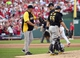 Oct 3, 2013; St. Louis, MO, USA; Pittsburgh Pirates manager Clint Hurdle (left) comes out to the mound with catcher Russell Martin (55) to relieve starting pitcher A.J. Burnett (middle) in the third inning in game one of the National League divisional series playoff baseball game against the St. Louis Cardinals at Busch Stadium. Mandatory Credit: Scott Rovak-USA TODAY Sports