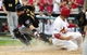 Oct 3, 2013; St. Louis, MO, USA; St. Louis Cardinals center fielder Jon Jay (19) slides safely past Pittsburgh Pirates catcher Russell Martin (55) to score a run during the third inning in game one of the National League divisional series playoff baseball game at Busch Stadium. Mandatory Credit: Jeff Curry-USA TODAY Sports