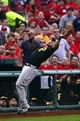 Oct 3, 2013; St. Louis, MO, USA; Pittsburgh Pirates third baseman Pedro Alvarez (24) makes a catch against the St. Louis Cardinals in game one of the National League divisional series playoff baseball game at Busch Stadium. The Cardinals defeated the Pirates 9-1. Mandatory Credit: Scott Rovak-USA TODAY Sports